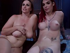 Bound busty babe licked out by trans chick