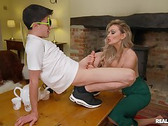 Sophisticated blonde MILF Amber Jayne enlightens a younger beggar