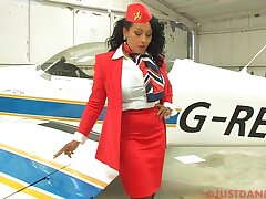 Busty stewardess Danica Collins takes off her panties alongside tease